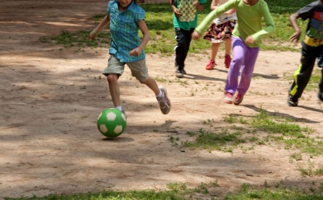 boys-and-girls-as-they-were-playing-an-informal-game-of-soccer-725x482-630x390